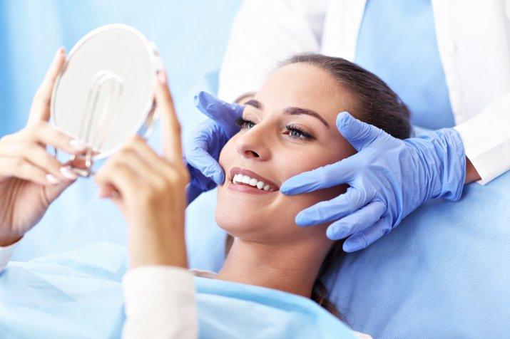 ORAL CARE-dentist-woman-whitening-smile-shutterstock-1216755457_10023